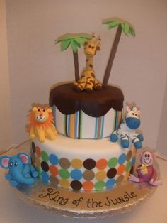 """@Amy Saltis ideas for baby shower cake...I ordered fondant 2"""" animals similar to this."""