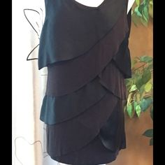 Sleeveless Layered A-Sym Statement Beautiful 95 Rayon 5 Spandex and 100 Poly layered sleeveless and seamless trimmed asymmetrical top. Look beautiful on! Black on Black Lucy & Laurel Tops