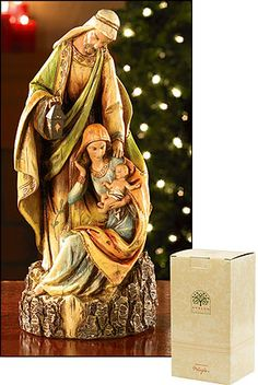 """Woodcut Holy Family Figurine from the Avalon Collection. Presented in a beautiful Avalon Gallery signature box for easy gift giving. Price includes shipping within the continental United States. We are pleased to present these beautiful Christmas figurines from Avalon Gallery. Each piece is lovingly created to celebrate the reason for the season ~ Christ in our midst. Dimensions: 12"""" high. Material: Resilient resin. Absolutely stunning detail from top to bottom!."""