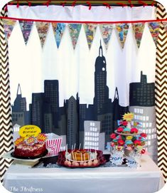 white backdrop, black/grey felt city outline    Pampers, Play Dates and Parties: {Featured Parties} Superhero Baby Shower