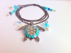 Sea Turtle Charm Necklace Swarovski by ClearWaterDesignsbyK, $36.67 This Pretty Sea Turtle Charm Necklace features an AB Swarovski Crystal Starfish. Https://clearwaterdesignsbyk.etsy.com Https://clearwater.info  ***AB stands for Aurora Borealis, or the way the light it reflects so many colours***.  The back of this Sea Turtle is embedded with crystals & it's shell is outlined with Turquoise Enamel. This Sea Turtle Pendant is made with metal alloy in a Gun Metal Tone and so is the chain.