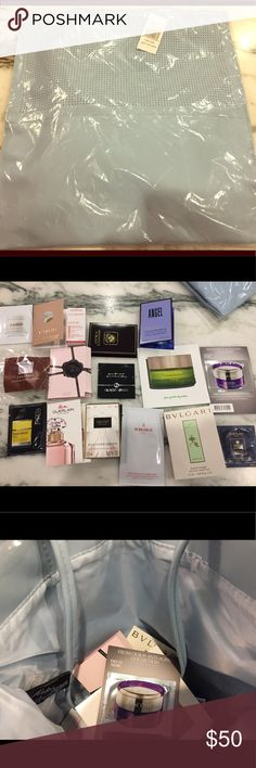 Saks Fifth Ave Beauty Event Bag and Samples Just In! Saks beauty event blue bag with 16 samples. Please see picture for details. La Mer soft cream, SK2, Giorgio Armani, Guerlain, Lancôme, Bulgari, and tons of perfume samples. All brand new. Makeup