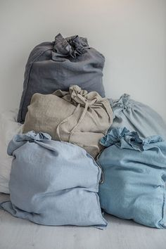 Big handmade linen laundry bag.  Choose color on the right. The colors on the first photo (from the left to the right): graphite, bluish grey, white, natural, ice blue/silver grey, Swedish blue.  Our items are made of washed linen fabric, specially woven for us by our local linen manufacturers. The procedure of making these items takes time and effort, cause the items are double washed once they are made. Only after such process we reach extra softness and natural wrinkles. DESCRIPTION: -100…