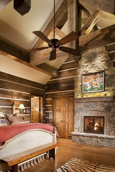 Love how a routine vaulted ceiling and walls become so cabin cozy with a bit of old lumber here!