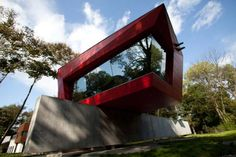"""Residential Architecture: D Gallery & House by Point B Design: """"..a pre-fabricatedgallery for a private art collection, a residential renovation, pool house, and encompassing grounds. a series of weathered steel framesplaced at regular intervals rest upon a thick concrete anchor spanning the length of the gallery. clad with a bright red mosaic of panels,the upper level is comprised of a metal construction that cantilevers on three wide flange beams attached to a similar…"""