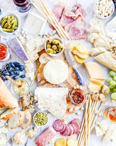 A picnic cheese plate with meats and grapes