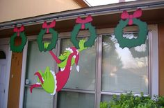 "This Grinch was custom made for client by ART DE YARD - Grinch swinging on 2 wreaths measures 53"" tall x 48"" wide.  Additional wreaths (sold separately) measure 24"" tall x 19"" wide."