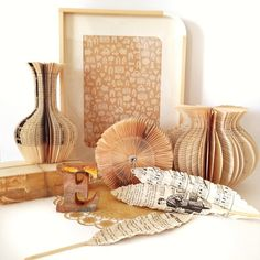 7 vignettes, day 7.. paper. Old books turned into vases. Book sculpture, book folding, feathers