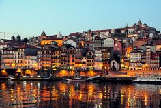 Nighttime view of harbour, Porto, Portugal by flickr user mandalaybus