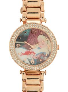Rose gold tone wristwatch with Alice In Wonderland -themed design, bling detailing, Japanese quartz movement and a rose gold tone metal band.