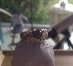 14k gold lost wax cast ring with red rose-cut diamond set in a lotus flower. Made by PhBeads on Etsy.