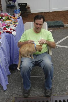 Making a new friend at Ridgewood Veterinary Hospital's Adopt-A-Pet Day.