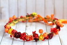 Weddbook is a content discovery engine mostly specialized on wedding concept. You can collect images, videos or articles you discovered  organize them, add your own ideas to your collections and share with other people | An unique Autumn Woodland flower crown in dark red and orange, with orange and red berries. It\'s perfect for Autumn weddings, flower girls or Photo prop. This lovely rustic crown is ideal for a country ot farmhouse wedding! Perfect fall hair wreath for brides, bridesmaid...