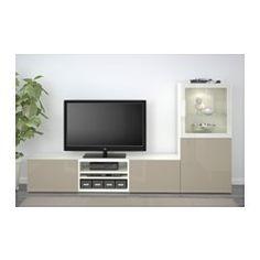 IKEA - BESTÅ, TV-Komb. mit Vitrinentüren, schwarzbraun/Selsviken Hochgl beige Klargl, Schubladenschiene, Drucksystem, , Durch die integrierten Drucköffner sind Knöpfe oder Griffe überflüssig – leichter Druck genügt.Dank mehrerer Öffnungen auf der Rückseite der TV-Bank lassen sich Kabel von Fernseh- und anderen Geräten verdeckt, aber griffbereit ordnen.Dank der Kabelöffnung auf der Oberseite der TV-Bank lassen sich Anschlüsse in den Bankkorpus leiten.Schubkästen erleichtern das Ordnen und...