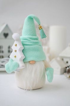 adorable Christmas gnome in white with mint-green hat and mittens, carrying a white Christmas tree - SalvabraniEver since a visit to Denmark I really liked the Scandinavian Christmas gnomes (or tomte, nisse. Diy Xmas, Diy Christmas Gifts, Christmas Projects, Holiday Crafts, Christmas Decorations, Christmas Ornaments, Gnome Ornaments, White Christmas Trees, Christmas Gnome