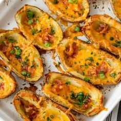 Homemade Baked Potato Skins {Crispy & Tasty} – Spend With Pennies I love these Crispy Homemade Baked Potato Skins! These are done up in the oven so they aren't greasy but they are crispy, cheesy and bacon-y—which are things all yummy snacks should be! Potato Skins Appetizer, Crispy Potato Skins, Potatoe Skins Recipe, Twice Baked Potato Skins Recipe, Potatoes In Oven, Baked Potato Oven, Twice Baked Potatoes, Roasted Potatoes, Healthy Superbowl Snacks