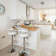 White modern kitchen with mini peninsula
