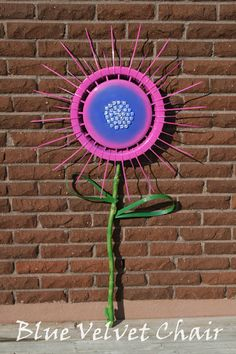 hubcap garden - going to do this on the back of our little garage - seeable from the road - can't wait!!