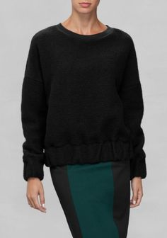 This warm sweater with a fuzzy feel is made for a loose fit and features chunky cuffs and hem with hidden elastic.