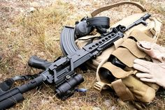 VZ-58 with NEA handguard, FAB Defense grip, angled adjustable stock, scope and side mount, and a nylon mag pouch.