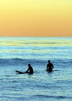 Like San Diego sunsets with surfers waiting for one last set despite feeding time for sharks