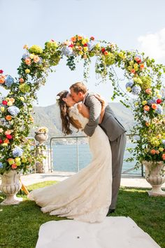 Talk about a romantic ceremony arch & passionate first kiss! // Christine Chang Photography