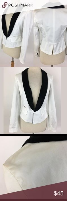 Guess tuxedo jacket Length Shoulder To Hem: 21 Bust: 34.5 Waist: 30 Fabric Content: 98% cotton, 2% Spandex This has some minor marks on it.  They are very minor and not obvious, but there are several, most notably on the left shoulder. Please note pictures.   Item #94 Guess Jackets & Coats