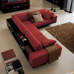 Mad Men style corner sofa - with a bookcase on the back... ArredaClick - Italian design furniture blog