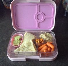 My first attempt with June's new Yumbox Panino! Garlic Naan bread with hummus, cucs, carrots and pizza goldfish.