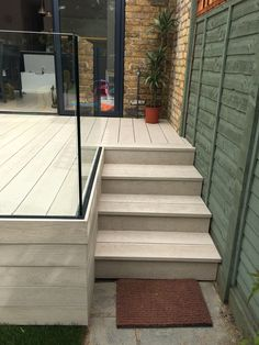 Millboard Composite Decking and Elite Balustrade (no railing stairs into back yard)