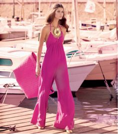 The perfect monochromatic jumpsuit with matching bag to wear while sipping slow gin fizzes on the bay.