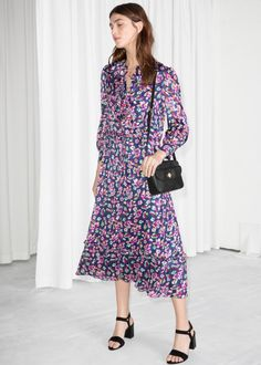 Model front image of Stories floral print maxi dress in blue