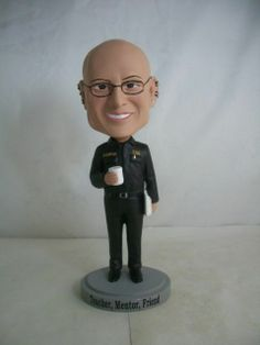 """http://youbobble.com/  They do custom bobble head dolls.  This is what we had made for an instructor we had who retired.  The """"Doctor"""" doll was used and cost us about $250CDN.  After final proofing was agreed upon, delivery was within 2 weeks. I highly recommend them."""