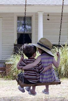 children sharing the swing..Sooooo sweet.