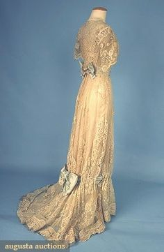 1908 Tea Gown  1-piece, Brussels applique lace trimmed w/ pale blue silk satin ribbons & bows, lined in cream silk satin. (side view)