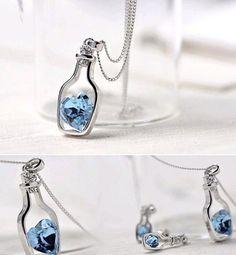 Blue Heart Crystal Bottle Pendant Necklace. Starting at $1