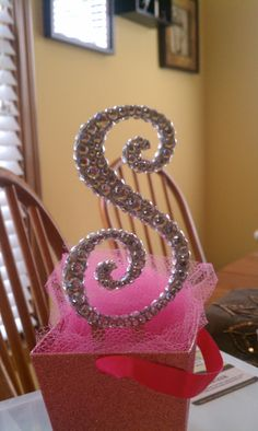 Gorgeous monogram cake topper covered in rhinestones. Makes it sparkle from every angle. Only $75 on Etsy.