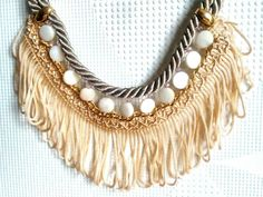 Check out this item in my Etsy shop https://www.etsy.com/listing/210367397/beige-rope-peach-tassels-white-beads