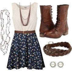 White lace top, navy floral skirt, brown belt and boots