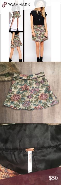 """Free People Tapestry Skirt Size 12.  Free People Skirt.  Tapestry style fabric with lining.  Features front pockets, zipper at side and detail at waist.  16"""" waist,  18"""" length Free People Skirts"""