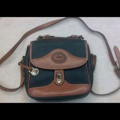 Dooney & Bourke cross body Vintage cross body. In good used condition. Authentic Dooney & Bourke Bags Crossbody Bags