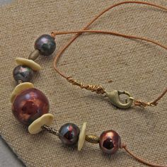 Handmade Raku Orb Bone and Brass on Leather Necklace by oscarcrow on Etsy