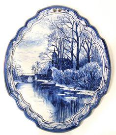 A Makkum Tichelaar Delftware Blue and White Oval Landscape