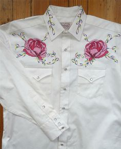 This is the original design from our archive brought back by popular demand.   Features beautiful floral embroidery, single point pockets, relax fit, import.   Fabric is 100% cotton Gabardine twill, year around weight.- Vintage design, floral embroidery- 100% Cotton Gabardine twill, year around weight- Double Needle Construction- Tapered Fit