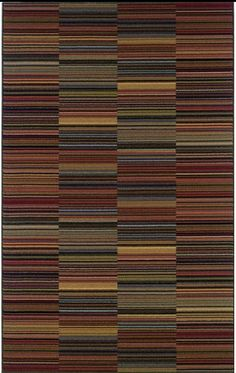 A moving scheme of dark, tribal colors and stripes -- great area rug for a contemporary or modern graphic living room. | Bolero Multi Area Rug cort.com