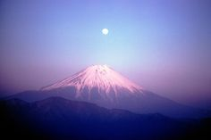 Japan, Mount Fuji. Full moonrise over Mount Fuji viewed from Mount Sichimen. 1961. By Burt Glinn.