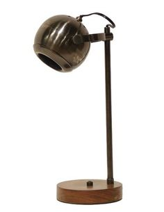 Palecek's Orbit solid brass lamp mixes a modern shape with an antique bronze finish and wood base. WTC 515. www.palecek.com