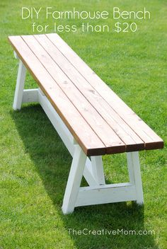 White and brown DIY Farmhouse bench made from 2x4 wood on green grass