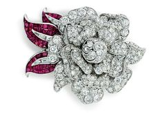 A diamond and ruby 'mystery-set' flower brooch, by Van Cleef & Arpels