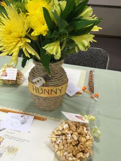 Table setting for Stephanie's vintage Winnie the Pooh baby shower. Tiger tail favors, caramel corn, and place settings by Aunt Sandy. Centerpieces by Lise. Honey sticks for favors as well.